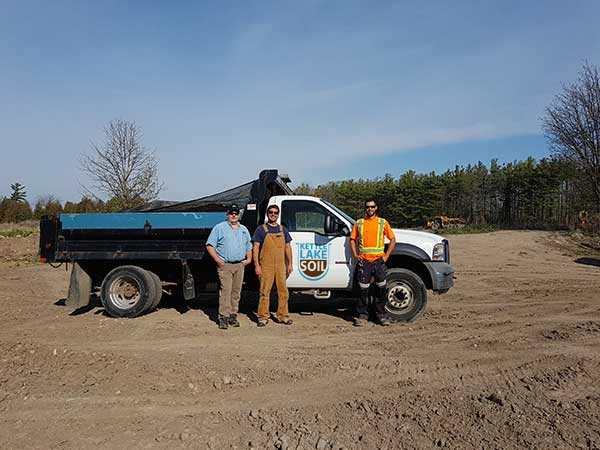 kettle lake topsoil team in front of topsoil delivery truck